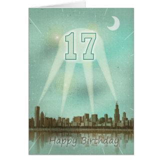 17o Cartão de aniversário com uma cidade e os