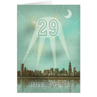 29o Cartão de aniversário com uma cidade e os