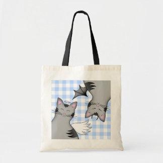 2 lados a um gato, a um bom gatinho e a um gato ma bolsa para compras