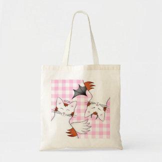 2 lados a um gato, a um bom gatinho e a um gato ma bolsas