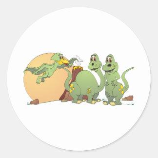 3 dinossauros amigáveis adesivos redondos