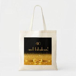 40 e arco dourado elegante fabuloso no bolsa preto