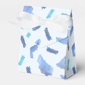 A aguarela azul mancha a caixa do favor da barraca