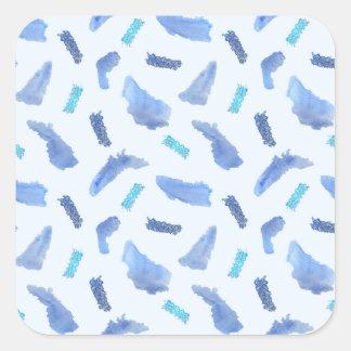 A aguarela azul mancha a grande etiqueta quadrada