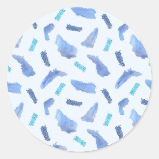 A aguarela azul mancha a grande etiqueta redonda