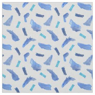 A aguarela azul mancha o tecido do Poplin do