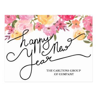 A aguarela floresce a tipografia do feliz ano novo cartão postal