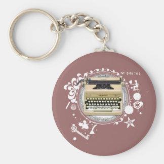 A alquimia da máquina de escrever da escrita chaveiro