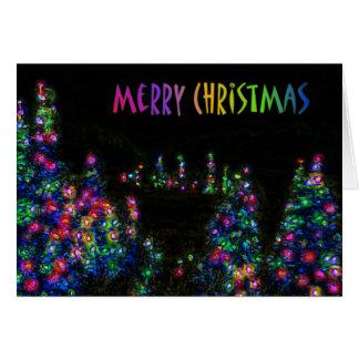 A árvore do Feliz Natal ilumina o cartão
