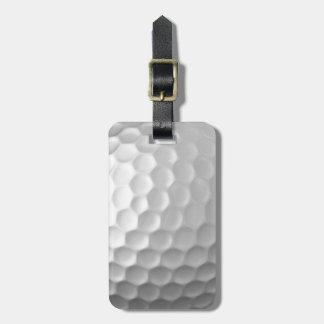A bola de golfe ondeia o teste padrão da textura tags de mala