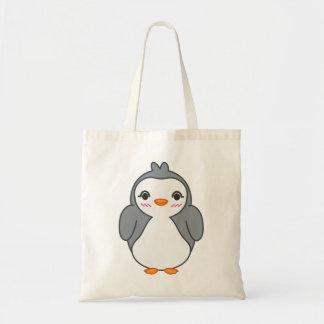 A bolsa de compra bonito do pinguim
