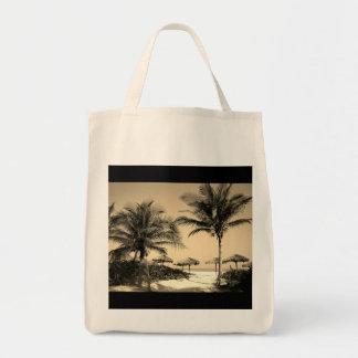 A bolsa de compra da foto da praia do vintage