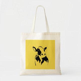 A bolsa de compra feliz da vaca