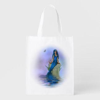A bolsa de compra reusável da sereia azul sacolas ecológicas para supermercado