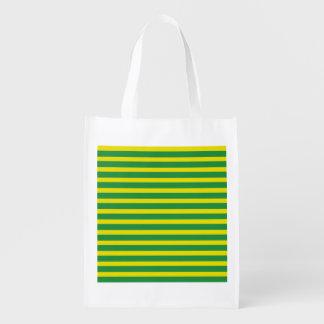 A bolsa de compra reusável das listras amarelas e sacolas reusáveis