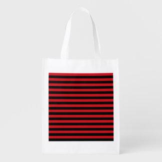 A bolsa de compra reusável das listras vermelhas e sacola reusável