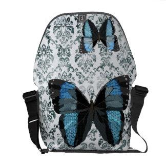 A bolsa mensageiro azul da borboleta de Boho