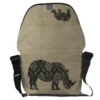 A bolsa mensageiro da silhueta dos rinocerontes pr