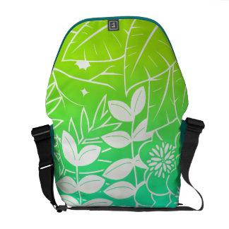 A bolsa mensageiro tropical de néon da folha