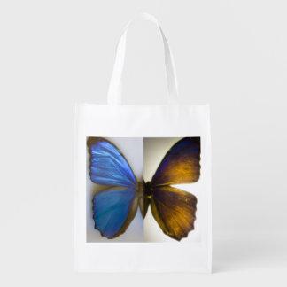A borboleta azul de Morpho voa o saco reusável Sacola Ecológica