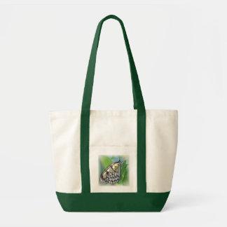 A borboleta voa a sacola das canvas bolsa para compra