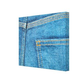 A calças de ganga suporta canvas do bolso