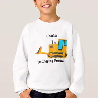 A camisa do miúdo da escavadora