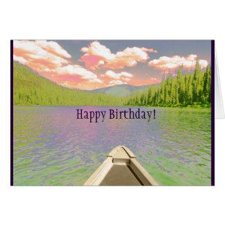 A canoa do cartão de aniversário no lago