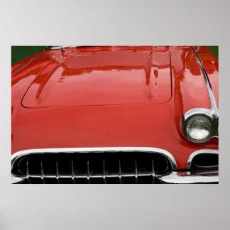 a capa de um carro de esportes vermelho clássico posteres