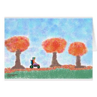 A cara legal rola através do cartão das folhas