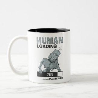 A carga humana, espera por favor a caneca de café