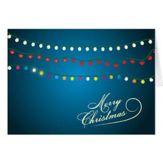 A corda do Feliz Natal ilumina o cartão do feriado