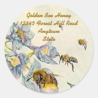 A corriola das abelhas do mel da etiqueta floresce