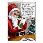 A criança engraçada suborna o cartão de Natal do p