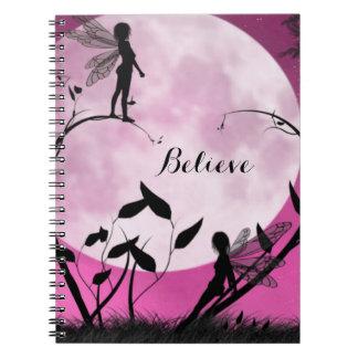 A fada acredita o caderno