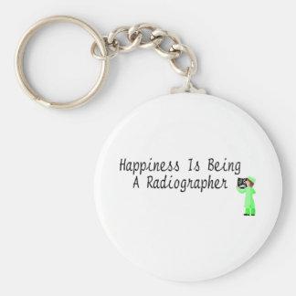 A felicidade está sendo um técnico de radiologia chaveiro