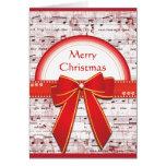 A fita vermelha do Feliz Natal nota o cartão