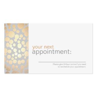 A folha de ouro do falso circunda o cartão cinzent cartão de visita