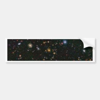 A galáxia distante estoura com estrelas adesivo para carro