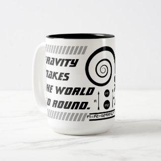 A gravidade faz o mundo ir circularmente caneca de café em dois tons