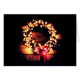 A grinalda do Feliz Natal ilumina a foto do cartão