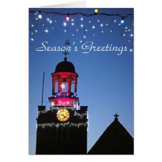 A igreja ilumina o cartão de Natal