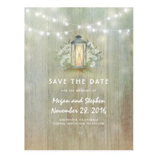 A lanterna do vintage e as flores brancas salvar a cartão postal
