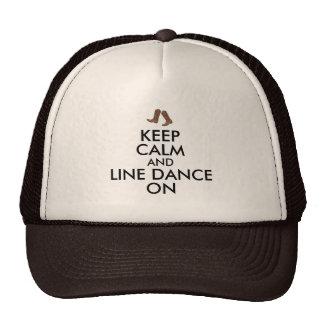 A linha presente da dança mantem botas de vaqueiro boné