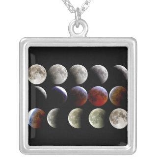 A lua durante um eclipse lunar completo pingentes