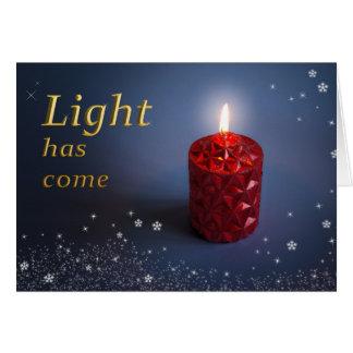 A luz tem o cartão de Natal cristão vindo