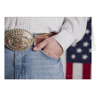 A mão do homem no bolso de seus jeans cartão comemorativo