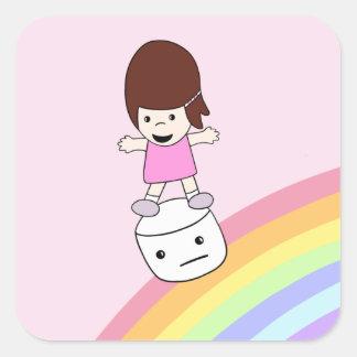 A menina bonito surfa o arco-íris na etiqueta do