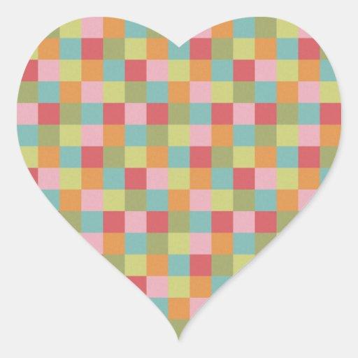 A multi edredão colorida dos azulejos esquadra a adesivos de corações