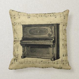 A música antiga do piano nota o instrumento do almofada